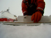 Graduate student Jessica Cross cuts an ice core.